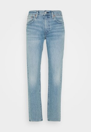 502™ TAPER - Slim fit jeans - light-blue denim