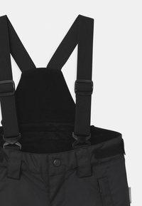 Reima - WINTER TERRIE UNISEX - Zimní kalhoty - black - 3