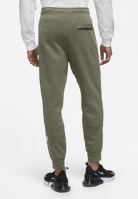 Nike Sportswear - REPEAT - Tracksuit bottoms - medium olive - 2
