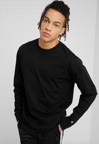 Carhartt WIP - BASE - T-shirt à manches longues - black/white - 0