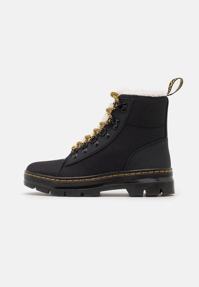 COMBS - Platform ankle boots - black