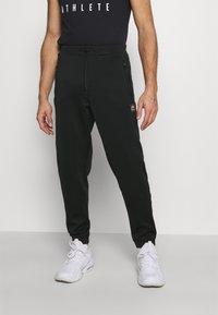 Ellesse - ROMFORD - Pantalones deportivos - black - 0