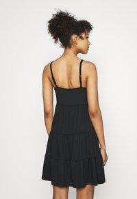 Hollister Co. - PRIDE CAPSULE EMBROID BABYDOLL DRESS - Jersey dress - black - 2