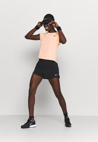 Nike Performance - T-shirts - arctic orange - 1
