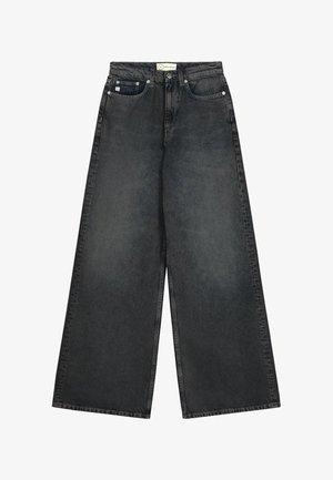 Flared Jeans - heavy black stone