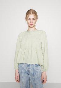 Monki - MARIA PEPLUM BLOUSE - Long sleeved top - green dusty light - 0