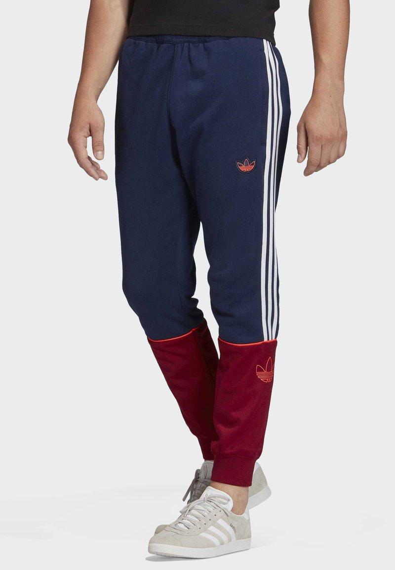 adidas Originals - OUTLINE JOGGERS - Tracksuit bottoms - blue