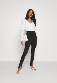 Gina Tricot - JADA SLIT - Leggings - Trousers - black - 1