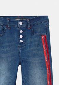 Guess - JUNIOR HIGH WAIST SKI - Jeans Skinny Fit - blue denim - 2