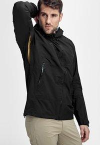 Mammut - CONVEY TOUR - Hardshell jacket - black - 4