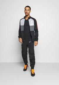 Nike Performance - LIVERPOOL PANT - Tracksuit bottoms - black/white - 1