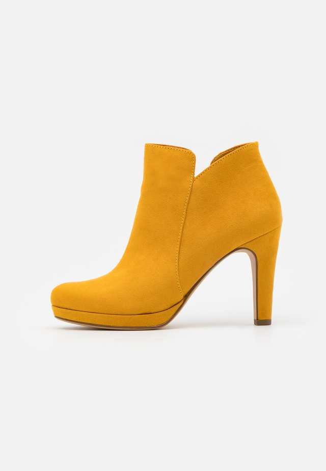 High heeled ankle boots - mustard