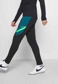 Nike Performance - DRY ACADEMY PANT  - Tracksuit bottoms - black/dark teal green/green strike - 3