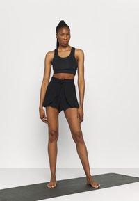 Cotton On Body - DOUBLE LAYER PETAL HEM SHORT - Sports shorts - black - 1