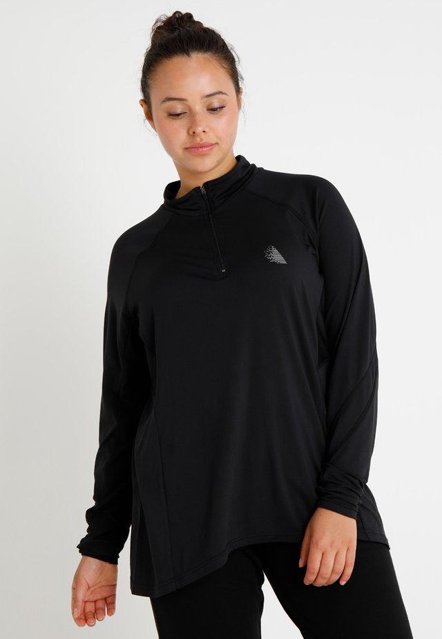 ADUBAI - T-shirt sportiva - black