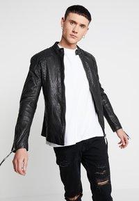 Tigha - NERO - Leather jacket - black - 0