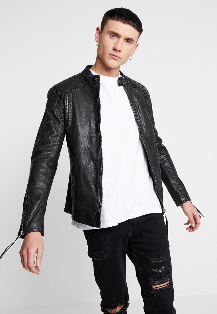 Tigha - NERO - Leather jacket - black