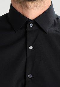 Calvin Klein Tailored - BARI SLIM FIT - Formal shirt - black - 3