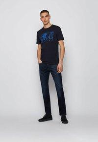 BOSS - TEALLY - Print T-shirt - dark blue - 1