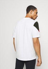 Puma - REBEL ADVANCED TEE - T-Shirt print - white - 2