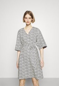 Marimekko - IHMETYS PIKKUINEN UNIKKO DRESS - Day dress - black/off-white - 0