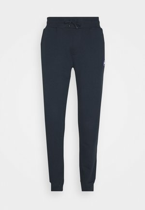 MENS PANTS - Tracksuit bottoms - dark blue