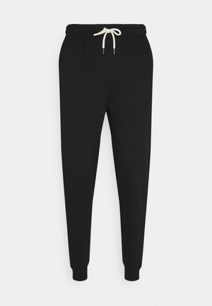 TRIPPY TRACKIE - Tracksuit bottoms - peached black