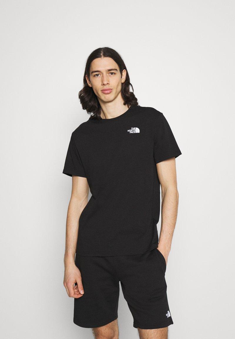 The North Face - DISTORTED LOGO - T-shirt med print - black/peak purple