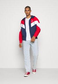Nike Sportswear - Windbreaker - midnight navy/university red/white - 1