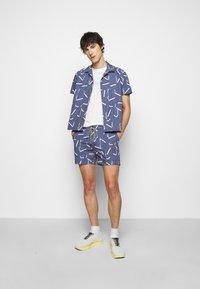 Viktor&Rolf - ALLOVER PRINTED SHORTS - Shorts - navy - 1
