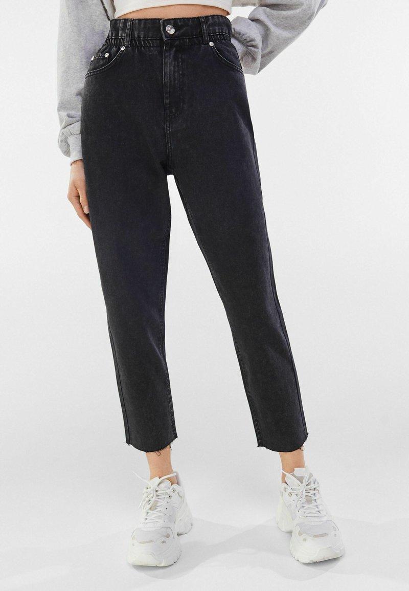 Bershka - Jeans a sigaretta - dark grey