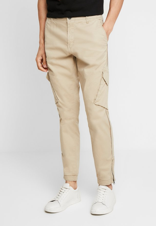 BATTLE ZIP - Cargo trousers - beige