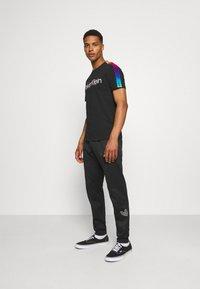 adidas Originals - Träningsbyxor - black - 1