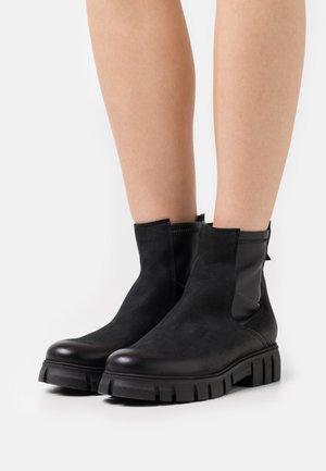 SAURA - Platform ankle boots - pacifico/ wonderful black