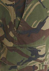 Polo Ralph Lauren - STRETCH SLIM FIT TWILL CARGO PANT - Cargo trousers - british elmwood - 4