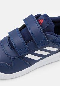 adidas Performance - TENSAUR UNISEX - Sportovní boty - dark blue/footwear white/active red - 5