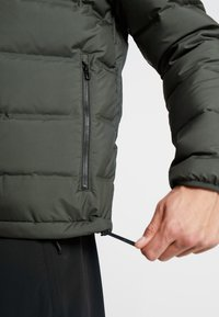 adidas Performance - HELIONIC DOWN JACKET - Chaqueta de invierno - olive - 4