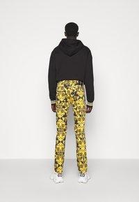 Versace Jeans Couture - TUPO - Slim fit jeans - black - 2