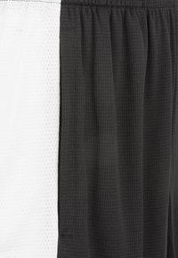 Puma - Sports shorts - black /white - 2
