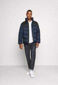 Redefined Rebel - PUFFER JACKET - Winter jacket - navy/black - 1