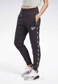Reebok - TAPE JOGGERS - Pantaloni sportivi - black - 0