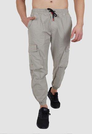 MIT ELASTISCHEM BUND - Cargo trousers - beige