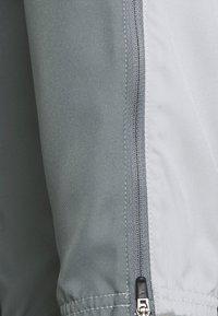 Nike Performance - ESSENTIAL PANT - Tracksuit bottoms - light smoke grey/smoke grey/silver - 5