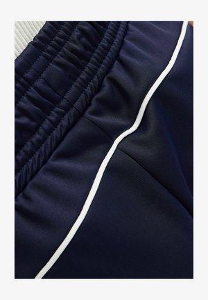 MIT SLOGAN - Pantalon de survêtement - blue