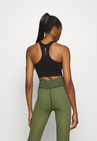 ONLY Play - ONPONITA CROPPED CIRCULAR - Medium support sports bra - black - 2