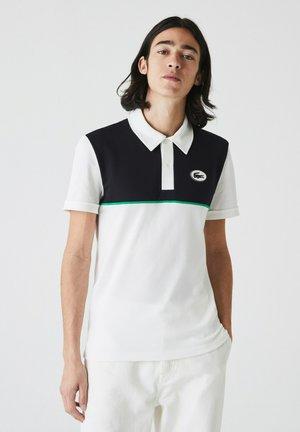 PH9767 - Polo shirt - weiß / navy blau
