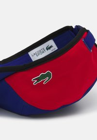 Lacoste Sport - TENNIS UNISEX - Casquette - cosmic/red white black