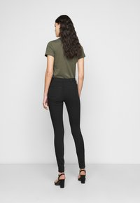 Vero Moda Tall - VMTANYA PIPING RAW - Jeans Skinny Fit - black - 2