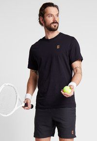 Nike Performance - COURT TEE - Basic T-shirt - black - 0