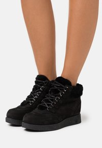 Unisa - CARRY - Lace-up ankle boots - black - 0